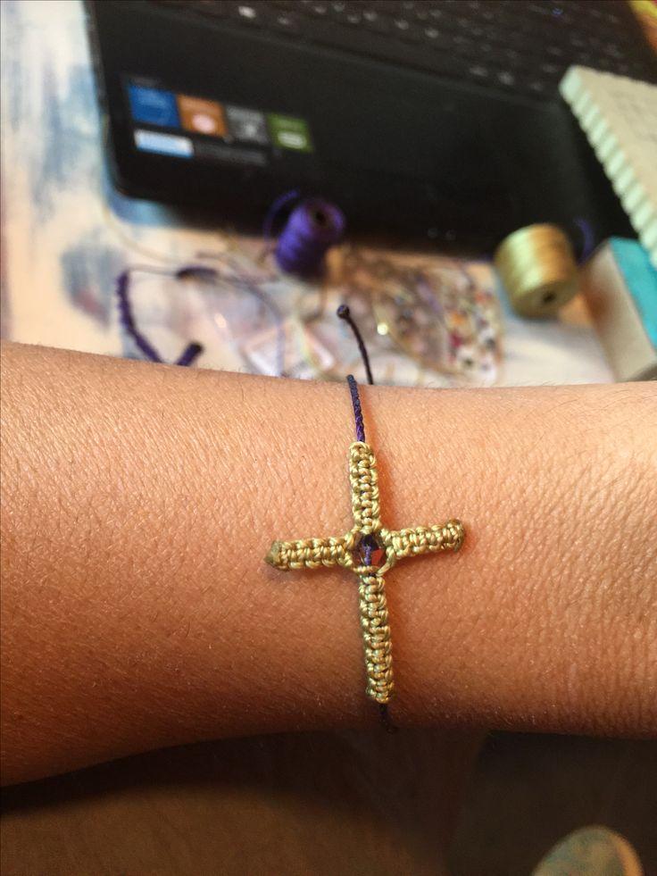 Macrame cross bracelet.
