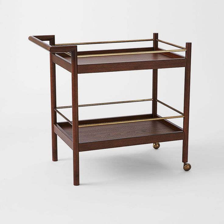 Parker Mid-Century Bar Cart http://www.westelm.co.uk/parker-mid-century-bar-cart-h415  W82 x D51 x H81cm Solid eucalyptus wood base; walnut veneer; Acorn-stained finish. Antique brass-finished rails and casters. Imported.