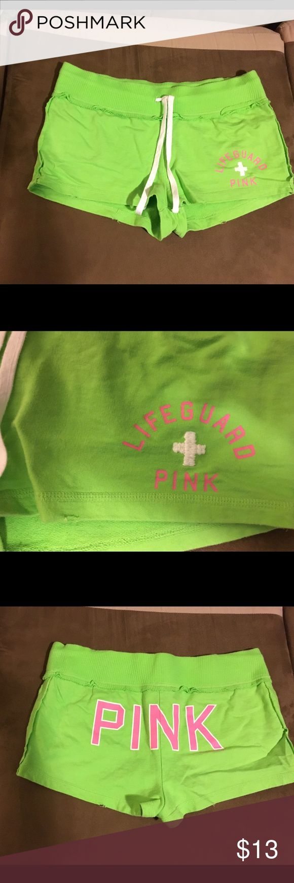 Pink Victoria's Secret Lime Green Shorts Small Lime Green with Pink and White Lifeguard print on front and Pink and White Pink printed on butt. These are size small with a drawstring waist.  The waistband edge is sticking up in a couple of places and there is a tiny bit of fray on the legs as pictured but came like this from store.  Have only been worn a few times and are in good condition from a smoke free home. 100% cotton. PINK Victoria's Secret Shorts
