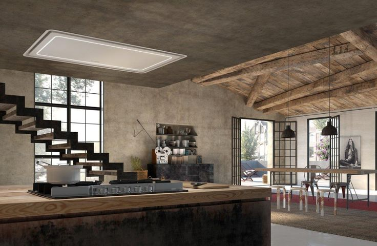 """High-Light, the innovative model with built-in design recessed in the ceiling, is marked by a thin steel panel with """"thin and light"""" lines and volume. It is the perfect hood for furnishing an island cooking hob."""