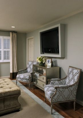 Seating area in master bedroom... don't have to have a TV on the wall like that, could substitute a large piece of art instead and get the same effect