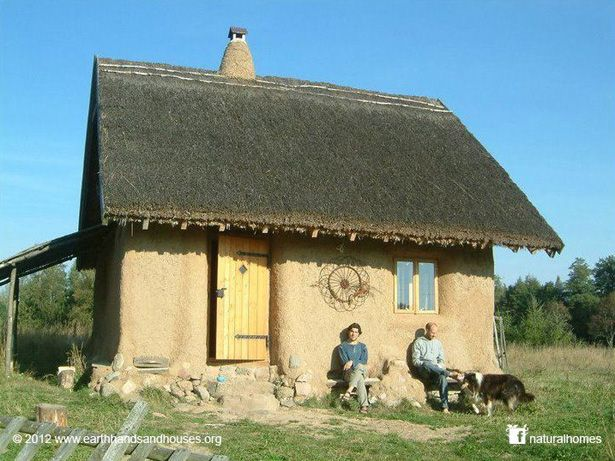 Dobra this straw bale cottage was built in poland by for House building costs