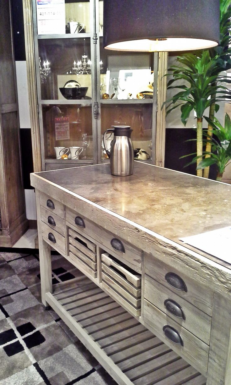This distressed wooden kitchen island with aged medal top screams industrial chic. | Houston, TX | Gallery Furniture |