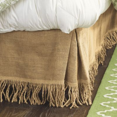 Add natural texture to your decor with a Ballard Bedskirt.  The fringed style is neutral while adding soft movement.  Fringed burlap bedskirt