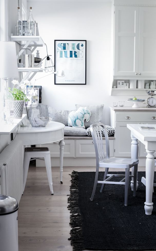 kitchen breakfast nook w/half round table, stool & box bench all tucked under kitchen window ledge. excellent use of space. would work well in my small but busy kitchen.