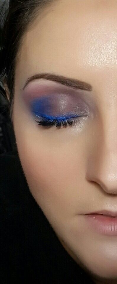 Purple and blue fading into pink with metallic blue eyeliner