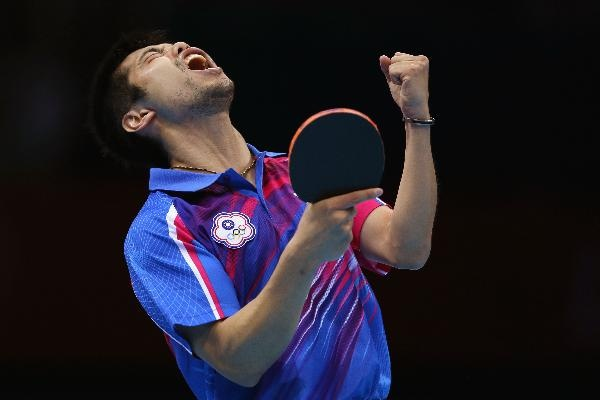 Chih-Yuan Chuang of Chinese Taipei celebrates a point during Men's Singles Table Tennis Bronze medal match against Dimitrij Ovtcharov of Germany on Day 6 of the London 2012 Olympic Games at ExCeL on August 2, 2012 in London, England. (Photo by Feng Li/Getty Images)