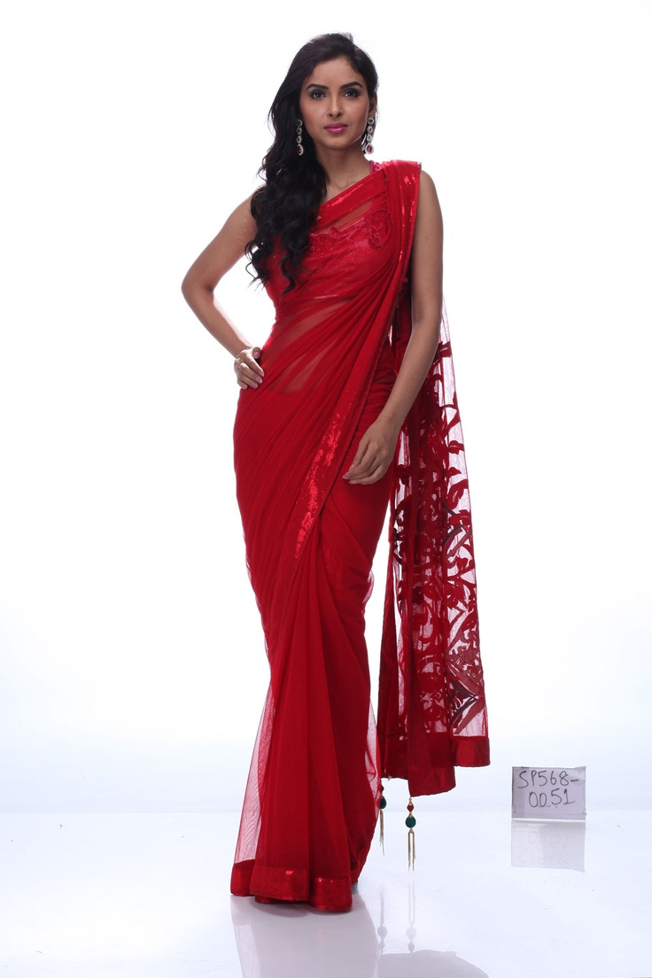 Hog limelight with this scintillating saree. The velvet shrub on the net base bestows the saree a mesmerizing feel. The delicate red satin border adds to its timeless appeal. This saree is perfect to cut a striking figure at any glamorous do.