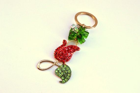 An impressiveBeaded Flower #Key Chain to put your  home or #car keys.. From a metal gold color  ring ,hanged a #beaded flower and acrylic square tube beads. Use this beautiful... #keychain #brelock #keys #house #key #holder #housewares #decoration #glossy #gemstones #enameled