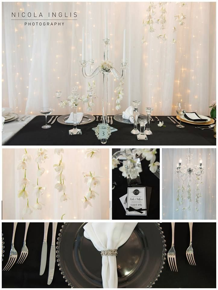 One of our bride's gorgeous setting with crystals and flowers draped over the candelabra. Photography by Nicola Inglis and setting by Blakes Hire.
