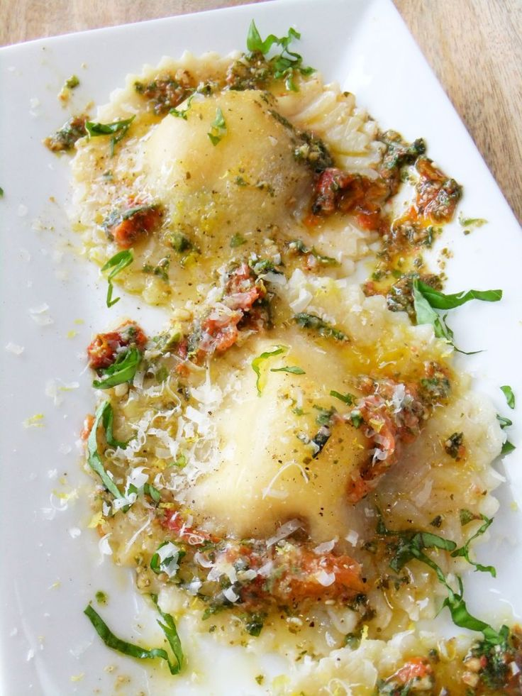 caprese ravioli with roasted tomato pesto sauce.  Great Appetizer for party!!