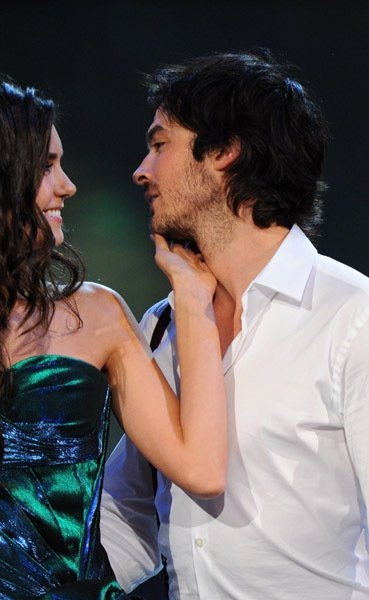 nina dobrev and ian somerhalder. running her hands along his jaw line along his stubble