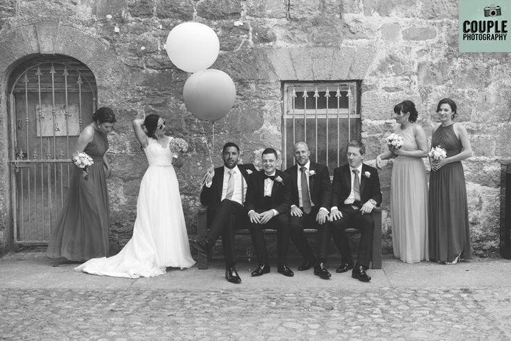 Natural, black & white photo of the bridal party. Weddings at The Radisson Galway photographed by Couple Photography.