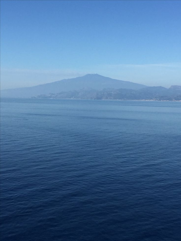 Our cruise ship is approaching the Strait of Messina. A beautiful view of Stromboli Volcano off the north coast of Sicily