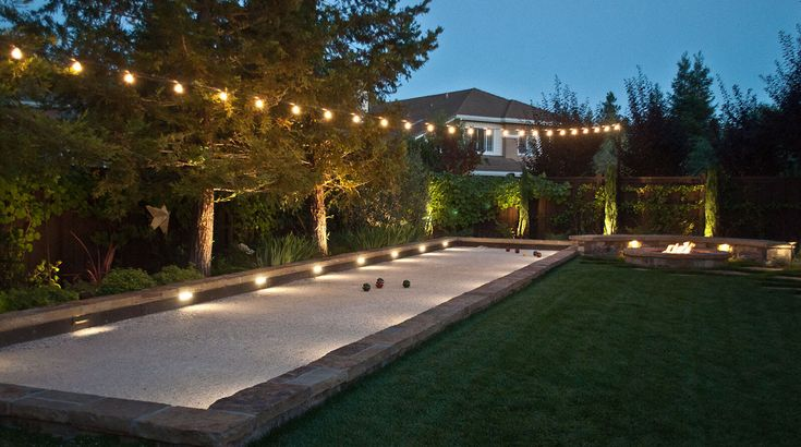 Bocce ball court with lighting surround made using stone
