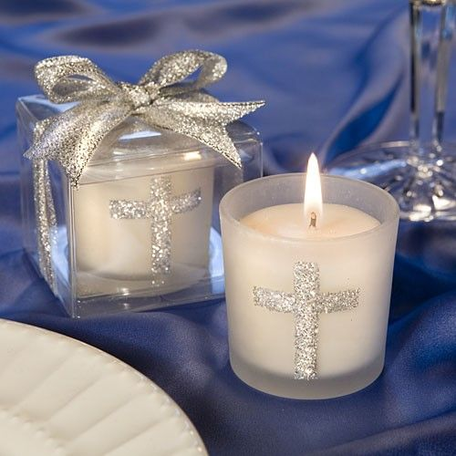 "Share a blessing with your family and friends with these silver cross themed candle favors  Looking for christening, first communion or confirmation favors, or classic gifts that are appropriate for any religious occasion?  These Fashioncraft-exclusive candles make a perfect choice!  Each 2"" x 1.75"" favor features a sturdy white frosted glass holder decorated with a sparkling silver cross design, with a white poured candle inside.  Packaged with punch, these candles come ready for dramatic…"