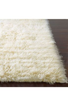 Looks so soft!!  I love a good flotaki rug!!! Great price and very durable.   It's a great transition rug between crazy orange persian in the living room and your striped rug in the master bedroom.  Would look great with blue wallpaper or seagrass wallpaper.
