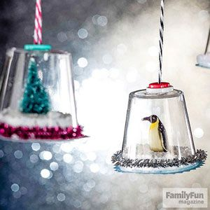 Creative Holiday Crafts for Kids: Mini Snow Globes (via FamilyFun Magazine) Plastic glass, cardboard traced for cover, figurine, and Epsom Salt for the snow... pipe cleaner for base, buttons laced with string and glued to hang up....