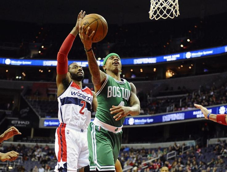Celtics guard Isaiah Thomas (23 points, 9 assists) got the better of Wizards counterpart John Wall (2).