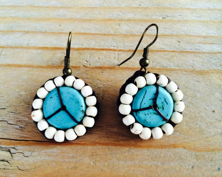 Peace Turquoise and white stones. In brown waxed cotton. Save to ware, Nickel and Lead free. €12,50