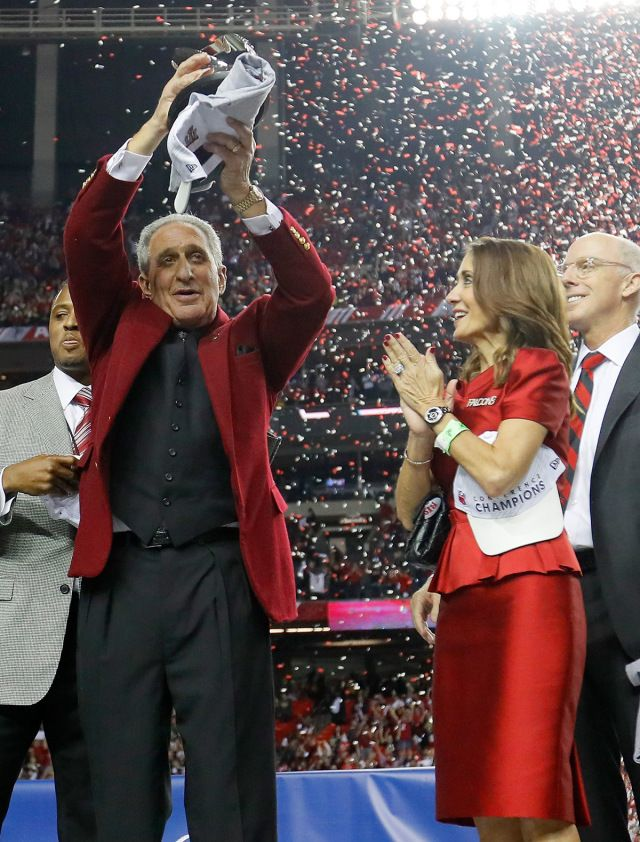 Atlanta Falcons owner Arthur Blank holds the George Halas Trophy after defeating the Green Bay Packers with hi wife, Angela Macuga, in the NFC Championship Game at the Georgia Dome on January 22, 2017 in Atlanta. The Falcons defeated the Packers 44-21. ( Kevin C. Cox/Getty Images)  Atlanta Falcons celebrate first Super Bowl bid in nearly 20 years | Atlanta Falcons blog: Atlanta football news