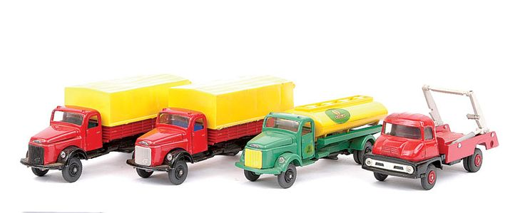 "Vilmer (Denmark) Volvo Tanker ""SLR Riksolja"" - green, yellow, 2 x Volvo Covered Dropside Truck - both red, black chassis, yellow canopy (1) blue interior, (2) green interior and Ford Thames Trader Skip Wagon - red, black chassis, red hubs"