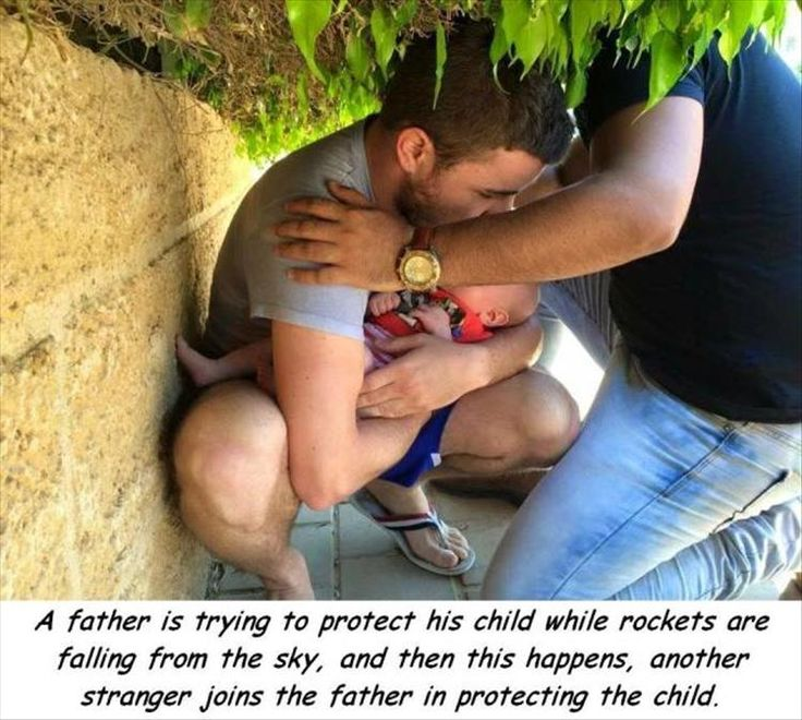 Israeli father protecting his child with the help of a stranger.