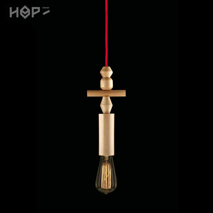 TOTEM lamp by HOP Design more: http://hop-design.eu/ buy here: http://www.fiufiushop.com/produkt/lampa-woody-totem/ Handmade turned wood lamps made by local craftsmen. Used with edison bulb by Epic Light. .