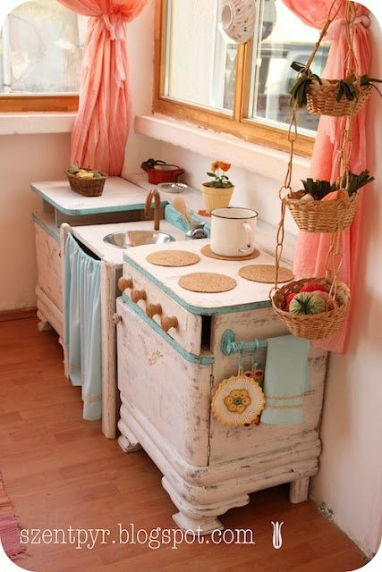 Pretty little toy kitchen.