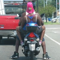 at least the pink will stand out better than his black helmet. I'll give her that.