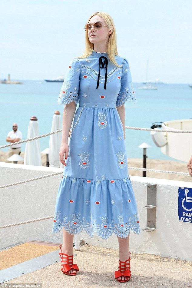 Chic: Elle Fanning was looking stylish when she stepped out bright and early during the Cannes Film Festival on Thursday morning, rocking a cute and quirky blue dress with red lip detailing