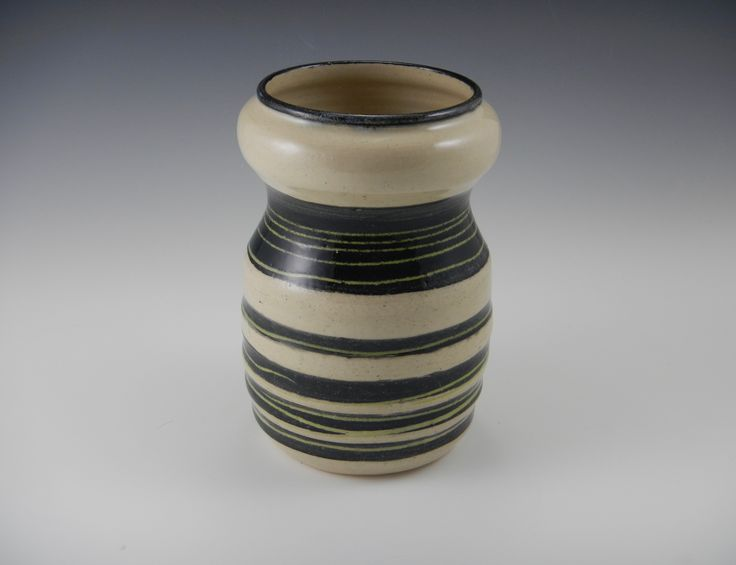 http://www.mimistadlerpottery.com/vases-with-flair/double-bubble-inlay-vase