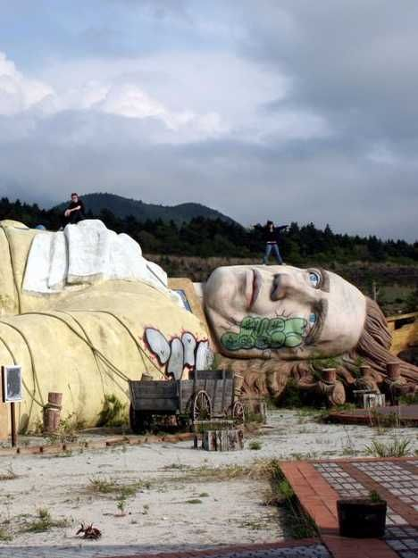 """Gulliver's Kingdom Theme Park, built in the shadow of Japan's Mount Fuji with oodles of government stimulus money, was a sprawling white elephant that existed for only 10 years. Today there's little if any trace of the abandoned theme park, its ruins, or Gulliver himself but the eerie and unsettling images captured by a legion of intrepid """"haikyo"""" explorers"""