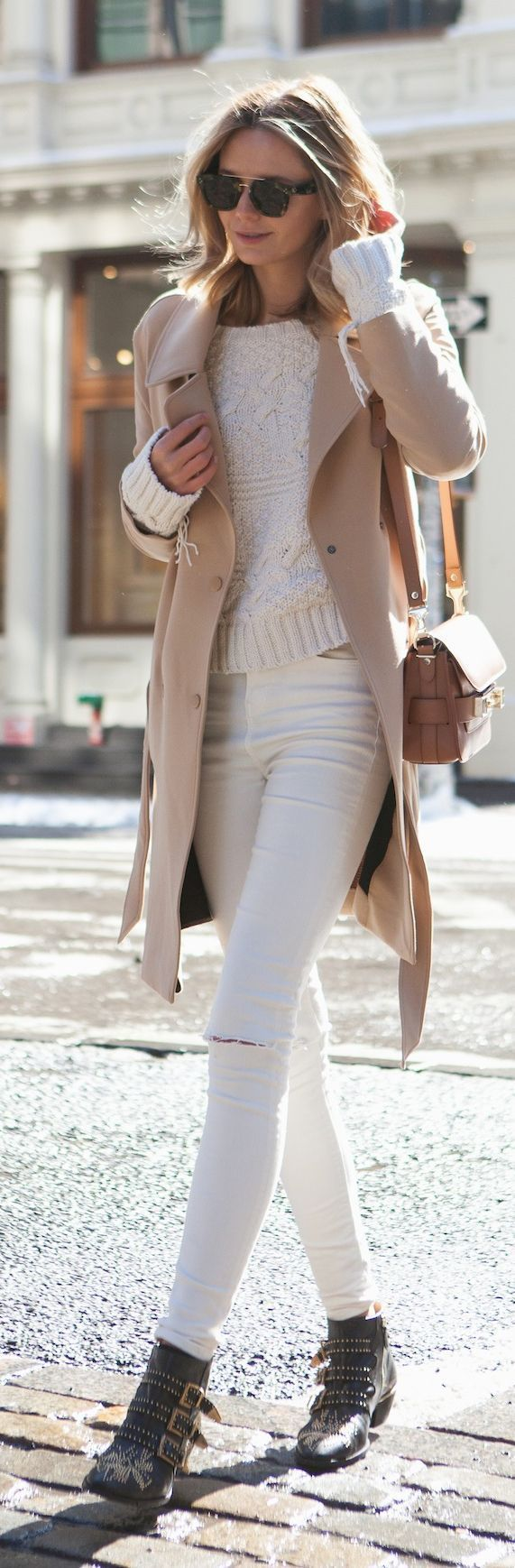 Wear a camel coat with white ripped skinny jeans to effortlessly deal with whatever this day throws at you. Black studded leather booties are a good choice to complete the look.   Shop this look on Lookastic: https://lookastic.com/women/looks/coat-cable-sweater-skinny-jeans/15361   — White Cable Sweater  — Camel Coat  — Tan Leather Crossbody Bag  — White Ripped Skinny Jeans  — Black Studded Leather Ankle Boots
