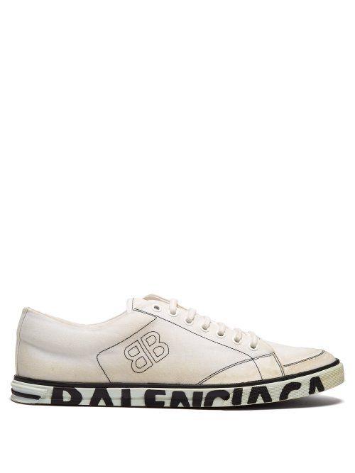 bb1d210b22a BALENCIAGA BALENCIAGA - DISTRESSED LOGO SOLE CANVAS TRAINERS - MENS -  WHITE.  balenciaga  shoes
