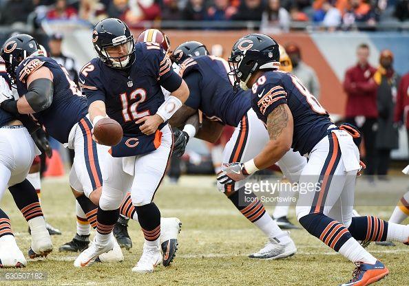 News Photo : Chicago Bears Quarterback Matt Barkley hands off...