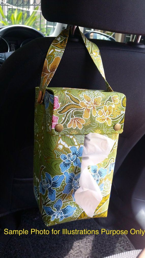 Dress up your tissue box with this contamporary tissue box cover!  Made of cotton print fabric, fully lined and interfaced for a sturdier look. This cover is sewn with a Button-on strap which can be used to be strap to the back of your car seat and is easy for you to carry it around. Flap are secured with brass snap button closure.  Approx Measurement :-  Height :- 9 inches / 23cm Width:- 5 inches / 13cm Depth:- 4.2 inches / 10cm Strap:- 13.5 inches / 34 cm  Fits into a jumbo size tissue box…
