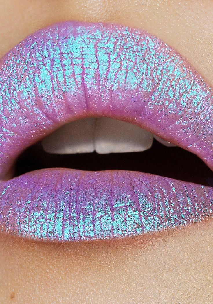 Lime Crime Trip Diamond Crusher Lip Topper will make 'em melt, babe. This incredible lip product will take yer shine into tha heavens with a smoooth, hyper glitzy purple 'N iridescent blue glitter pigment that ya can use on yer bare skin, lips, or on top of yer fav liquid lip.