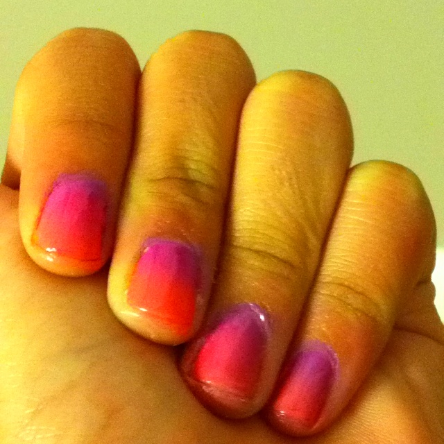 Ombré nails 1. Heavily paint three colors with nail polish on a make up sponge 2. Paint your nails with a solid color 3. Continuously dab the sponge on your nails until its opaque 4. Paint over with a clear coat Enjoy!(: