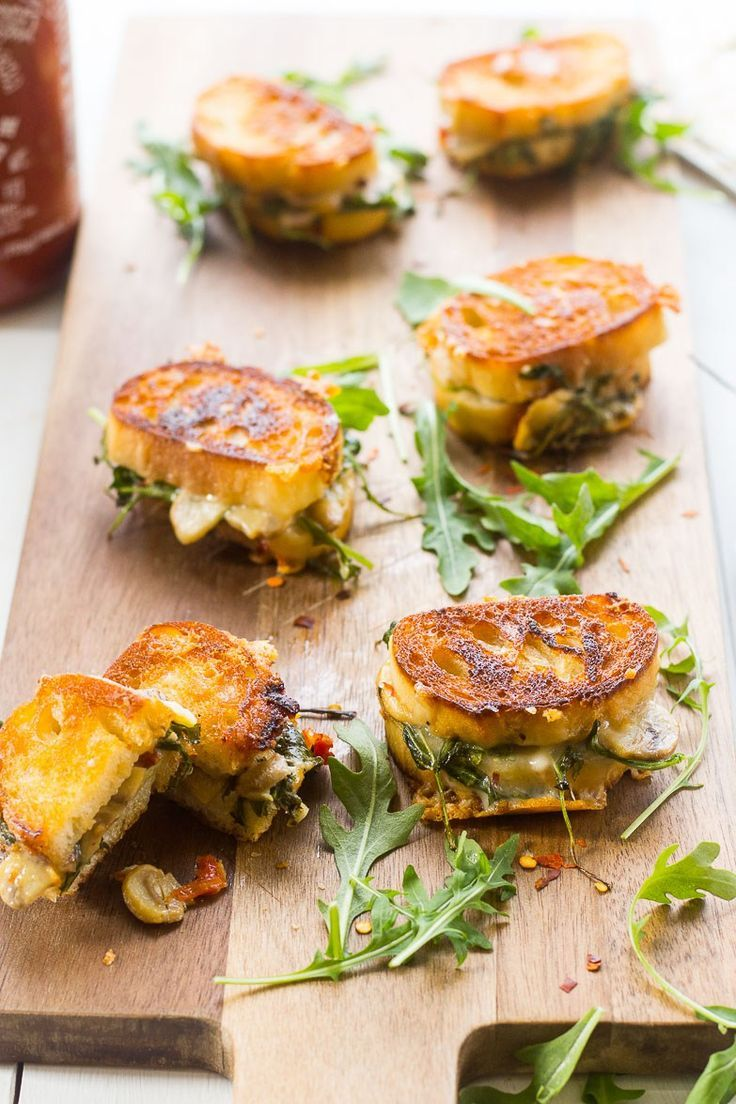 Mini Grilled Cheese Sandwich appetizers, filled with mushrooms, sundried tomatoes, aged cheddar and arugula!
