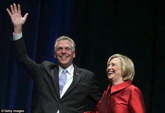 Best of friends: Virginia governor Terry McAuliffe with Hillary Clinton as she headlined a...