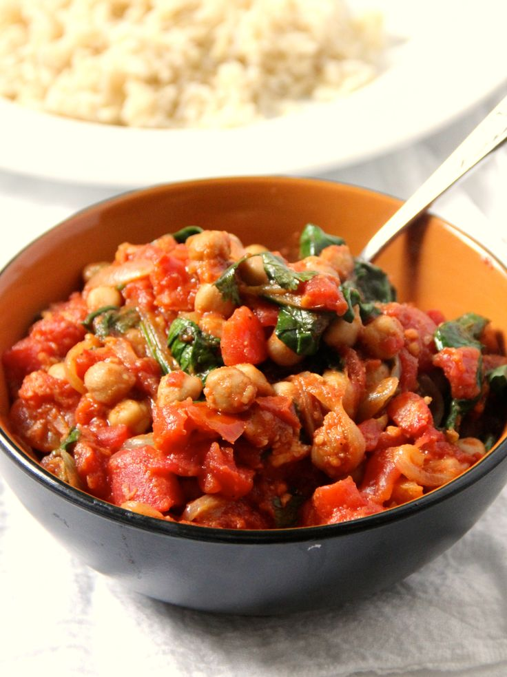 Spinach & Chickpea Curry - olive oil, onion, garlic cloves, fresh ginger, garam masala, cumin, cayenne pepper, chickpeas, canned chopped tomatoes, sugar (optional, would omit), fresh baby spinach, fresh coriander (optional), fresh lemon (optional), salt Y pepper