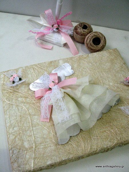Guest book decoration with girl dresses.