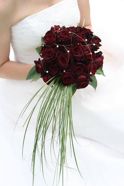 Nice deep red colored wedding flowers. #wedding #weddingflowers #weddingbouquets