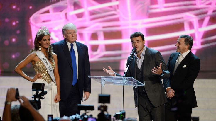 From left, Miss Connecticut USA Erin Brady and Donald Trump look on as Russian singer Emin Agalarov speaks onstage with his father Aras Agalarov during a news conference after Brady won the Miss USA 2013 pageant on June 16, 2013, in Las Vegas. JEFF BOTTARI / AP