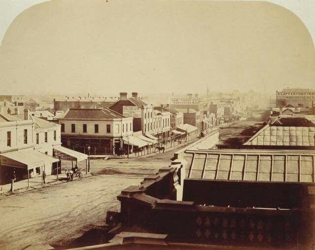 Melbourne's Collins Street in 1858 just some 23 years after first settlement. Swanston Street intersects it.
