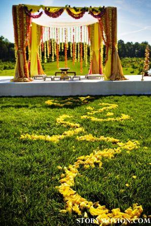 #yellow aisle covered in petals, #wedding mandap