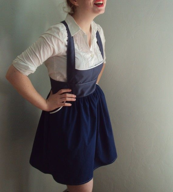 I rarely see this style of pinafore dress fit a figure so well. She looks cute!