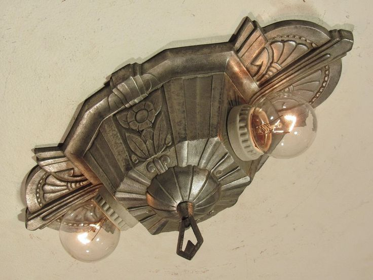 "This Awesome Antique Art Deco Two Light Fixture would make an Excellent Addition to your Home! This fixture is part of the classic ""Marietta"" Series made by Lincoln in the 1930's. It has beautiful floral details, and an outstanding overall shape. 
