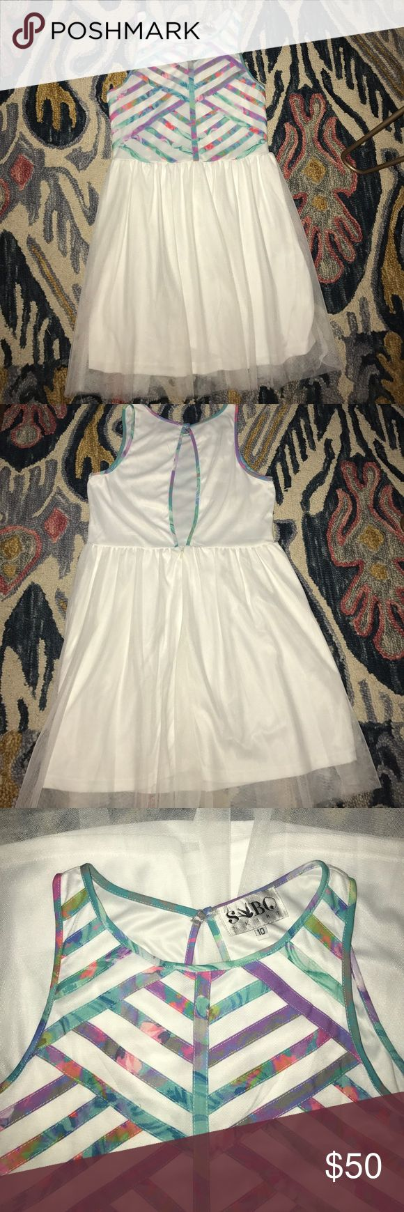 Sabo Skirt Colorful Dress White dress with tulle bottom, cut out back, and colorful stripes going across the chest. It's a Australian 10 but it would fit an extra small. New Without Tags. Sabo Skirt Dresses Mini